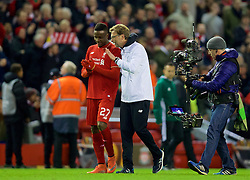 LIVERPOOL, ENGLAND - Thursday, March 10, 2016: Liverpool's manager Jürgen Klopp celebrates the 2-0 victory over Manchester United with Divock Origi after the UEFA Europa League Round of 16 1st Leg match at Anfield. (Pic by David Rawcliffe/Propaganda)