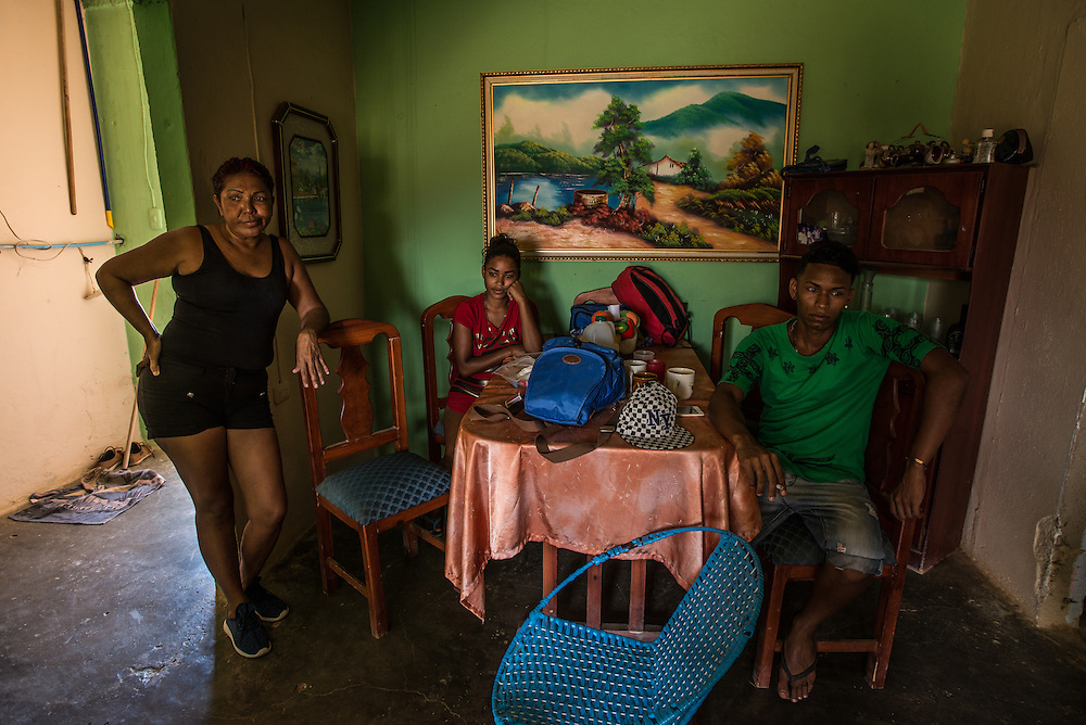 LA VELA, VENEZUELA - SEPTEMBER 25, 2016: Maria Pi&ntilde;ero (left) waits for a smuggler to come and tell her if the boat is leaving today or not with her son, Roger Bello (right) and his girlfriend Yaisbel, who is 6 months pregnant. Roger plans to make the trip to Curacao soon as well, in order to support Yaisbel and their baby. The wait is agonizing.  Smugglers tell migrants to be ready to leave any minute, but made them wait for weeks, delaying the departure date over 8 times. To escape the economic crisis in Venezuela, Ms. Pi&ntilde;ero spent all of her savings to pay smugglers to take her in a small fishing boat to Curacao island. &ldquo;I&rsquo;m nervous,&rdquo; she said. &ldquo;I&rsquo;m leaving with nothing. But I have to do this. Otherwise, we will just die here hungry.&rdquo;<br /> Despite having the largest known oil reserves in the world, Venezuela is suffering from hyperinflation and a severe economic crisis making affordable food difficult for most middle and working class families to access.  Well over 150,000 Venezuelans have fled the country in the last year alone, the highest in more than a decade, according to scholars studying the exodus. As Hugo Ch&aacute;vez&rsquo;s Socialist-inspired revolution collapses into economic ruin, as food and medicine slip further out of reach, the new migrants include the same impoverished people that Venezuela&rsquo;s policies were supposed to help. &ldquo;We have seen a great acceleration,&rdquo; said Tom&aacute;s Paez, a professor who studies immigration at the Central University of Venezuela. He says that as many as 200,000 Venezuelans have left in the last year, driven by how much harder it is to get food, work and medicine &mdash; not to mention the crime such scarcities have fueled.  PHOTO: Meridith Kohut for The New York Times