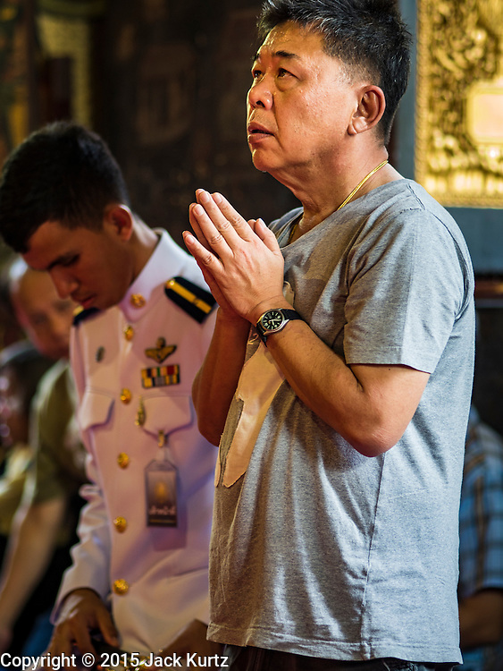 14 DECEMBER 2015 - BANGKOK, THAILAND:   A man prays for the Supreme Patriarch before the start of his funeral at Wat Bowon Niwet in Bangkok. Somdet Phra Nyanasamvara, who headed Thailand's order of Buddhist monks for more than two decades and was known as the Supreme Patriarch, died Oct. 24, 2013, at a hospital in Bangkok. He was 100. He was ordained as a Buddhist monk in 1933 and appointed as the Supreme Patriarch in 1989. He was the spiritual advisor to Bhumibol Adulyadej, the King of Thailand when the King served as a monk in 1956. His funeral, which will take three days,   Dec. 15-17, will be attended by thousands of Thais and most of the Royal Family. Buddhist clergy from around the world are expected to attend.     PHOTO BY JACK KURTZ