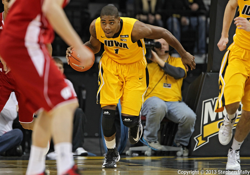 January 19 2013: Iowa Hawkeyes forward Melsahn Basabe (1) brings the ball down court during the first half of the NCAA basketball game between the Wisconsin Badgers and the Iowa Hawkeyes at Carver-Hawkeye Arena in Iowa City, Iowa on Sautrday January 19 2013. Iowa defeated Wisconsin 70-66.