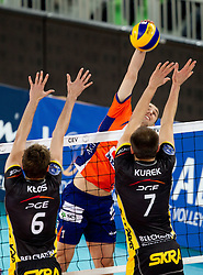 Andrej Flajs of ACH vs Karol Klos and Bartosz Kurek of Belchatow during volleyball match between ACH Volley LJUBLJANA and  PGE Skra Belchatow (POL) of 2012 CEV Volleyball Champions League, Men, League Round in Pool F, 4th Leg, on December 20, 2011, in Arena Stozice, Ljubljana, Slovenia. (Photo By Vid Ponikvar / Sportida.com)