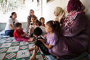 "** Note to Editor: Subject names deliberately omitted for protection**..Ecuador: UNHCR Special Envoy Angelina Jolie meets with Syrian refugees in the Bekaa Valley, Lebanon...The United Nations High Commissioner for Refugees António Guterres, and.his Special Envoy, Angelina Jolie, visited Lebanon today to hear.accounts from Syrian refugees and their host communities in the Bekaa.Valley and hold talks with the Government. Their trip comes as the.number of registered refugees here has risen to almost 67,000 as.violence continues unabated across the border. . .Speaking to the press following a meeting with Prime Minister Najib.Mikati, Mr. Guterres, recognizing their acute economic and security.concerns, paid tribute to Lebanon for providing asylum to so many Syrian.refugees. He called on the international community to recognize and help.ease Lebanon's burden. ""It is in everyone's interest to support not only.refugees but the States of the region,"" he added. . .At the same media briefing, Ms. Jolie remarked about her morning.experience meeting Syrian refugees here, ""I was moved to meet Syrian.families?in homes where they are welcomed and protected."". .She spoke of meeting three women living alone with their children,.leaving their husbands behind for fear they would be killed if they.attempted escape. One of the women tearfully described their sudden four hour trek to Lebanon leaving their father behind. Worried for their.lives if they remained, the mother told them they were visiting.relatives in neighboring Lebanon. ""They lost so much,"" she said. ""I just.didn't also want to break their hearts.""  ..©UNHCR/JTanner/Sept 2012"