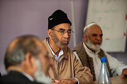 Community elders at a public meeting