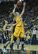 January 28, 2012: Iowa Hawkeyes center Morgan Johnson (12) tries to pull in a rebound during the NCAA women's basketball game between the Purdue Boilermakers and the Iowa Hawkeyes at Carver-Hawkeye Arena in Iowa City, Iowa on Saturday, January 28, 2012.