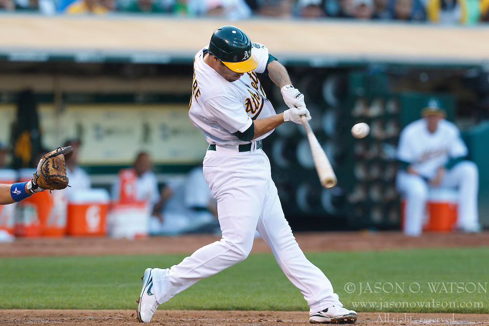 June 14, 2011; Oakland, CA, USA;  Oakland Athletics second baseman Scott Sizemore (29) hits a single against the Kansas City Royals during the second inning at Oakland-Alameda County Coliseum.