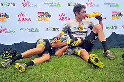 PAARL SOUTH AFRICA - MARCH 23: Riders comfort each other after a tough 70km final day, stage 7 on March 23, 2018 Wellingtion to Paarl, South Africa. Mountain bikers gather from around the world to compete in the 2018 ABSA Cape Epic, racing 8 days and 658km across the Western Cape with an accumulated 13 530m of climbing ascent, often referred to as the 'untamed race' the Cape Epic is said to be the toughest mountain bike event in the world. (Photo by Dino Lloyd)