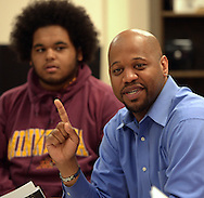 Minneapolis , MN -  April 27, 2015 - Michael Walker, head of the Minneapolis Public Schools new Office of Black Male Student Achievement, speaks during the Black Male Student Achievement meeting inside South High School on Monday, April 27, 2015. Juwan Child is the student sitting next to him. Photo by Johnny Crawford/ Johnny Crawford Photography