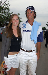 NINA VESTEY and JOHN PAUL CLARKIN at the Queen's Cup polo final sponsored by Cartier at Guards Polo Club, Smith's Lawn, Windsor Great Park on 18th June 2006.  The Final was between Dubai and the Broncos polo teams with Dubai winning.<br /><br />NON EXCLUSIVE - WORLD RIGHTS