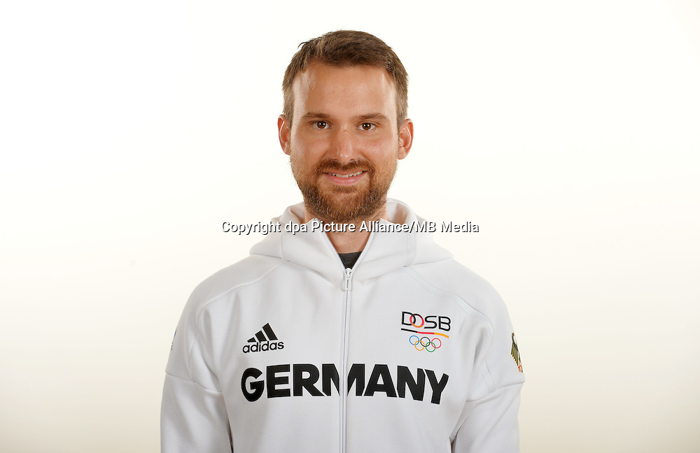 Johannes Nawrath poses at a photocall during the preparations for the Olympic Games in Rio at the Emmich Cambrai Barracks in Hanover, Germany. July 25, 2016. Photo credit: Frank May/ picture alliance. | usage worldwide