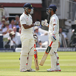 India's Ajinkya Rahane gets the 100 up for India during the first day of the Investec 2nd Test match between England and India at Lords, London, 17th July 2014 © Phil Duncan | SportPix.org.uk