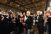 Ralph Lauren greets the audience after the Ralph Lauren 50th Anniversary Fashion Show during New York Fashion Week, Friday, Sept. 7, 2018. (AP Photo/Diane Bondareff)