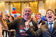 07 NOVEMBER 2012 - BANGKOK, THAILAND:  PAUL RISLEY, left, from Democrats Abroad, and DOUG deWEESE, an American living in Thailand, cheer as President Barrack Obama takes the electoral vote lead in the US election. They were election results at the US Embassy's election watch party in Bangkok. US President Barack Obama won a second term Tuesday when he defeated Republican Mitt Romney. Preliminary tallies gave the President more than 300 electoral votes, well over the 270 needed to win. The election in the United States was closely watched in Thailand, which historically has very close ties with the United States. The American Embassy in Bangkok sponsored an election watching event which drew thousands to a downtown Bangkok hotel. American Democrats in Bangkok had their own election watch party at a restaurant in Bangkok.      PHOTO BY JACK KURTZ