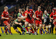 Picture by Andrew Tobin/Focus Images Ltd. 07710 761829. .27/12/11. Owen Farrell (13) of Saracens breaks past Chris Robshaw (7) of Harlequins during the Aviva Premiership match between Harlequins and Saracens at Twickenham Stadium, London.