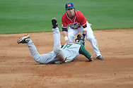 Tulane's Jeremy Schaffer (8) is safe as Ole Miss' Blake Newalu (6) applies the tag at Oxford-University Stadium in Oxford, Miss. on Sunday, March 6, 2010. Tulane won 3-1.