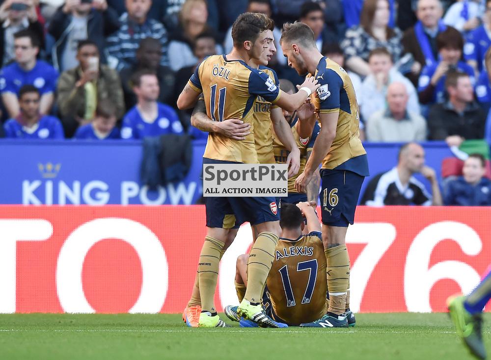Alexi Sanchez is on the floor as his teammates celebrate his goal to put Arsenal 2-1 up (c) Simon Kimber | SportPix.org.uk