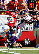 Minnesota Vikings wide receiver Devin Aromashodu (19) catches a first quarter touchdown pass good for a 7-3 lead while covered by Kansas City Chiefs cornerback Brandon Carr (39) during the NFL week 4 football game against the Kansas City Chiefs on Sunday, October 2, 2011 in Kansas City, Missouri. The Chiefs won the game 22-17. ©Paul Anthony Spinelli