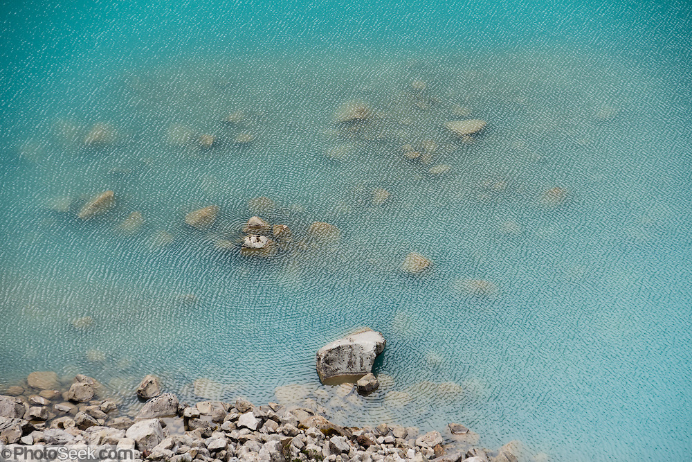 The turquoise waters of Jancarurish Lake are colored by glacial flour from Nevado Alpamayo (19,511 ft or 5947 m), in Alpamayo Valley, Cordillera Blanca, Andes Mountains, Peru, South America. Day 7 of 10 days trekking around Alpamayo, in Huascaran National Park (UNESCO World Heritage Site).