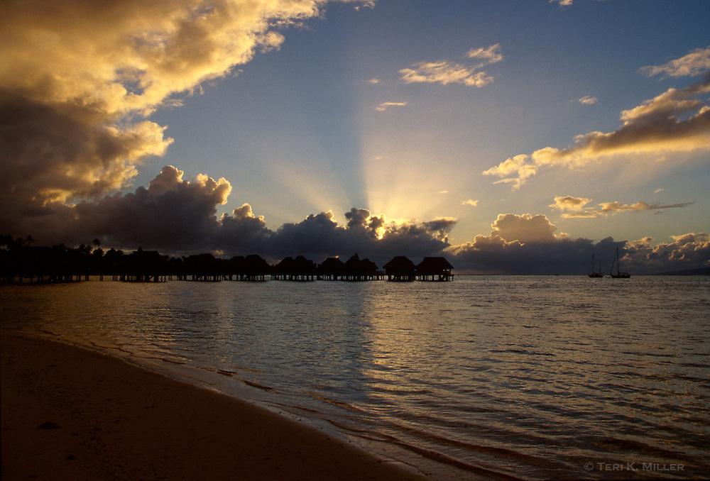 Sunrise over overwater bungalows at the Sofitel Ia Ora, Moorea, French Polynesia