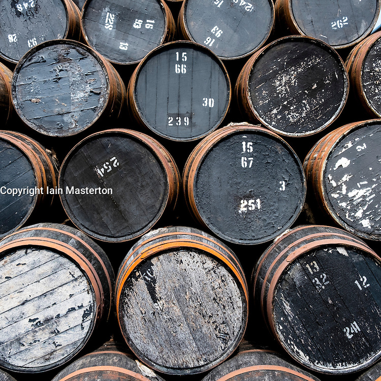 Empty whisky barrels at whisky distillery in Scotland, United Kingdom