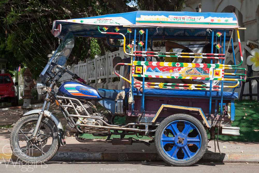 Laotian 'Jumbo' tricycle passenger auto-rickshaws in Vientiane, Laos