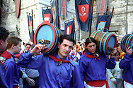 Gubbio 15 MAY 2004..Festival of the Ceri..The parade the ceraioli of St George whit the barrel....http://www.ceri.it/ceri_eng/index.htm..