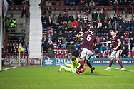 12th December 2017, Tynecastle Park, Edinburgh, Scotland; Scottish Premier League football,  Heart of Midlothian versus Dundee; Hearts' goalkeeper Jon McLaughlin saves at the feet of Dundee's Sofien Moussa