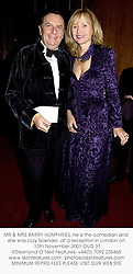 MR & MRS BARRY HUMPHRIES, he is the comedian and she was Lizzy Spender, at a reception in London on 13th November 2001.	OUD 37