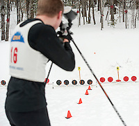 Tristan Smith of Newport takes the second of his five paintball shots during Gunstock Nordic's annual Paintball Biathlon event on Sunday.   (Karen Bobotas/for the Laconia Daily Sun)
