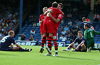Photo: Olly Greenwood.<br />Southend United v Cardiff City. Coca Cola Championship. 24/09/2006.  Cardiff's Joe Ledley celebrates scoring with Michael Chopra while the Southend player look dejected
