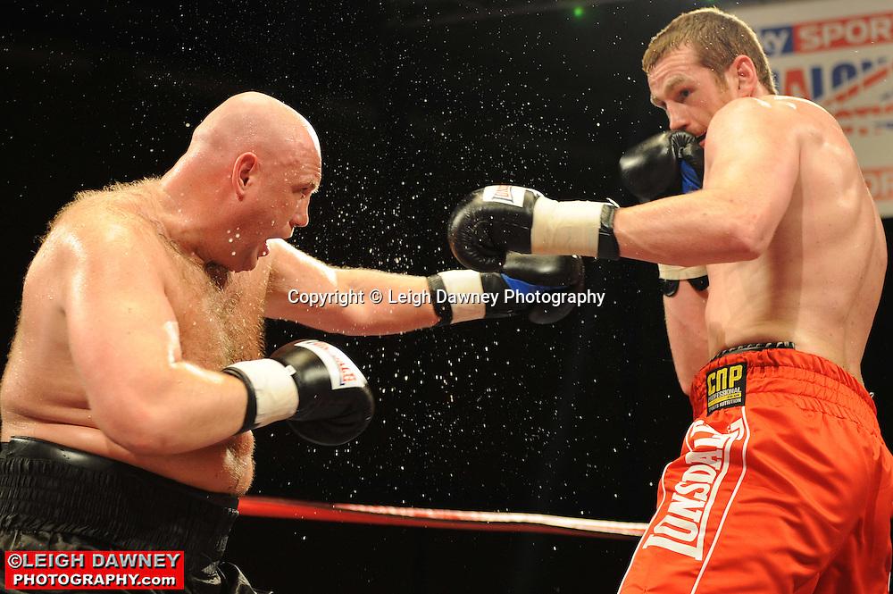 David Price (red shorts) defeats Daniil Peretyatko at Gorsebrook Leisure Centre Dagenham on 14th May 2010. Frank Maloney Promotions. Photo credit: © Leigh Dawney