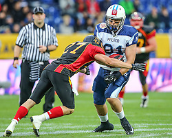 30.05.2014, NV Arena, St. Poelten, AUT, American Football Europameisterschaft 2014, Gruppe A, Deutschland vs Finnland, im Bild Mario Schmitt, (Team Germany, DB, #27) und Tommi Pinta, (Team Finland, WR, #81) // during the American Football European Championship 2014 group A game between Germany and Finnland at the NV Arena, St. Poelten, Austria on 2014/05/30. EXPA Pictures © 2014, PhotoCredit: EXPA/ Thomas Haumer