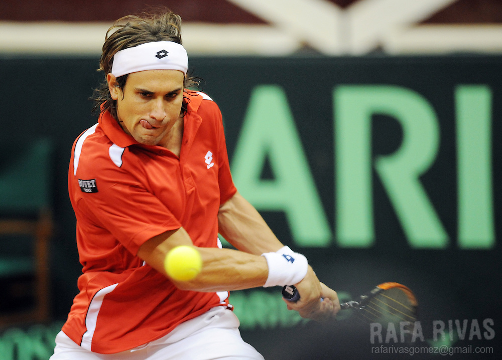 Spain's David Ferrer returns the ball against Switzerland's Marco Chiudinelli during their Davis Cup World Group first round tennis match in Logrono, North of Spain,  on March 5, 2010. Ferrer won the match. PHOTO/Rafa Rivas