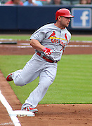 ATLANTA, GA - JULY 27:  Right fielder Matt Holliday #7 of the St. Louis Cardinals rounds first base heading to second base for a double in the 1st inning during the game against the Atlanta Braves at Turner Field on July 27, 2013 in Atlanta, Georgia.  (Photo by Mike Zarrilli/Getty Images)