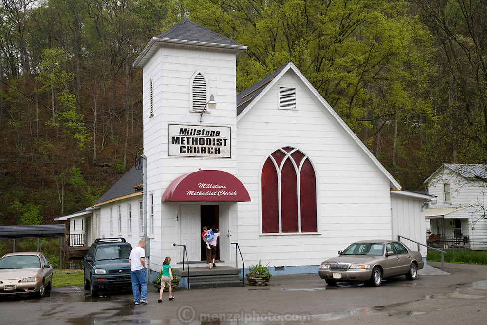 Todd and Cristy Kincer entering the Millstone Methodist Church, near Whitesburg, Kentucky, where coal miner Todd Kincer works. (Todd Kincer is featured in the book What I Eat: Around the World in 80 Diets.) The pastor of the church is Todd's father, Harold Kincer, himself a retired coal miner and county employee.