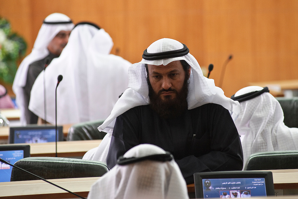 Member of Parliament Mohammed Hayef talks to a colleague on the sidelines of the inaugural session of the new National Assembly Feb. 15, 2012 in Kuwait City. Kuwaitis voted Feb. 2 for a new 50-member National Assembly (parliament).