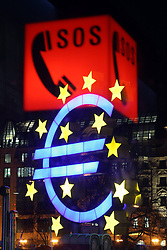 Emergency column with emblem SOS on red Ground reflected to in a Glass window before the Euro symbol before the ECB European Central Bank in Frankfurt at Evening Economy symbol. Photo by Imago/i-Images