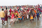 Hindu devotees are crossing a shallow section of the holy Ganges River during the yearly Sonepur Mela, Asia's largest cattle market, in Bihar, India.