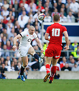 Mike Brown of England kicks past Rhys Priestland of Wales during the RBS 6 Nations match at Twickenham Stadium, Twickenham<br /> Picture by Andrew Tobin/Focus Images Ltd +44 7710 761829<br /> 09/03/2014