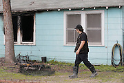 HFD investigators work the scene of a fatality fire at 5500 Bunte St. on Tuesday, March 22, 2016 in Houston, TX. Clinton Russell perished in the fire but his wife Kay Russell and his daughter Sandra Russell escaped the fire uninjured. (Photo: Thomas B. Shea/For the Chronicle)