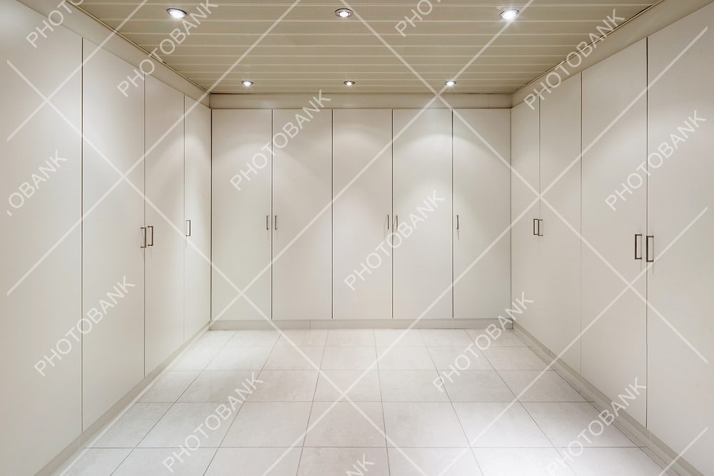 interior of an house, empty room with a closets, tiled floor