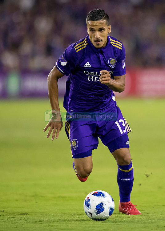 March 10, 2018 - Orlando, FL, U.S. - ORLANDO, FL - MARCH 10: Orlando City defender Mohamed El-Munir (13) looks to pass during the MLS Soccer match between Orlando City SC and Minnesota United FC on March, 10th 2018 at Orlando City Stadium in Orlando, FL. (Photo by Andrew Bershaw/Icon Sportswire) (Credit Image: © Andrew Bershaw/Icon SMI via ZUMA Press)