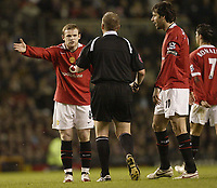 Photo: Aidan Ellis.<br /> Manchester United v West Ham United. The Barclays Premiership. 29/03/2006.<br /> united's Wayne Rooney complains to referee Graham poll