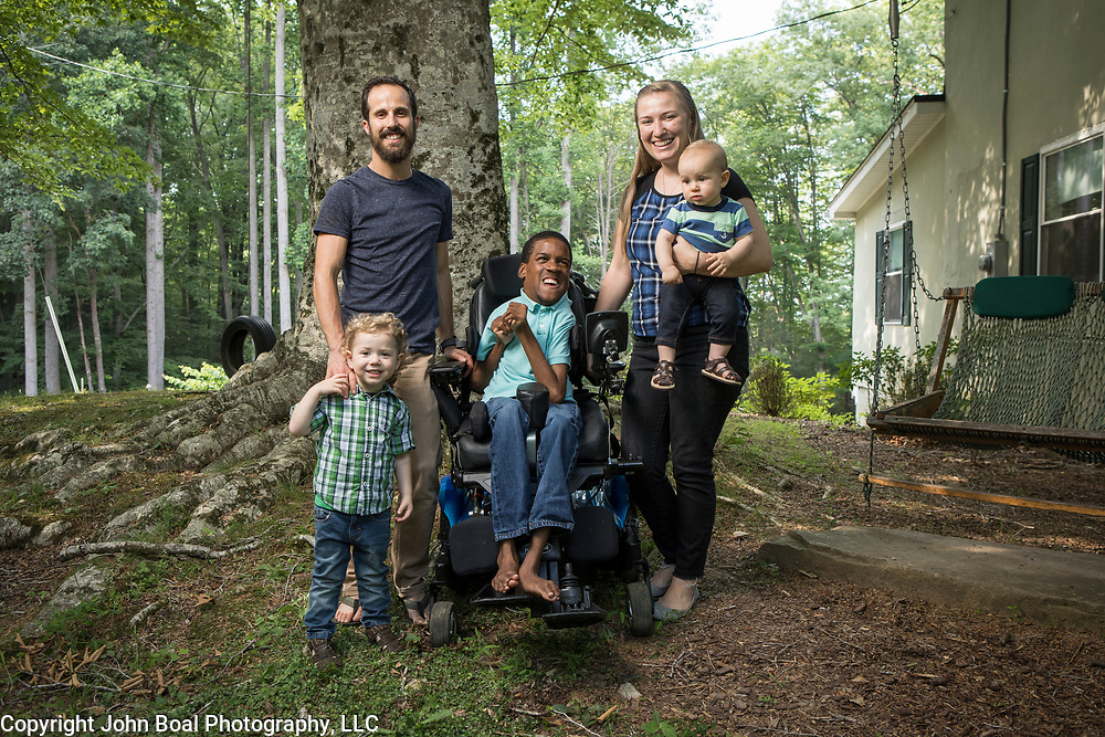 The Harms family and their adopted son, Donald, who has Cerebral Palsy. The father, Michael often runs with Douglas in a running stroller. For Novant Health