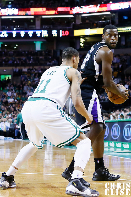 30 January 2013: Sacramento Kings point guard Tyreke Evans (13) looks to pass the ball over Boston Celtics shooting guard Courtney Lee (11) during the Boston Celtics 99-81 victory over the Sacramento Kings at the TD Garden, Boston, Massachusetts, USA.