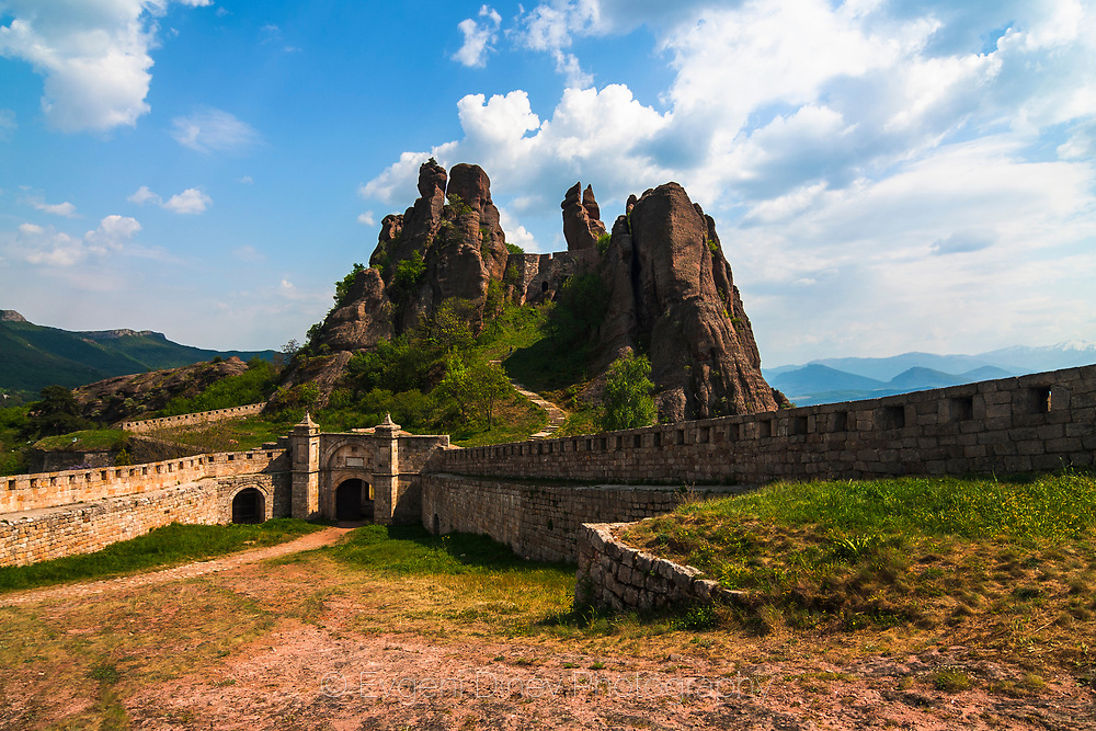 The Belogradchik Rocks are a group of bizarrely shaped sandstone, limestone and conglomerate rock formations. The rocks vary in color from primarily red to gray to yellow; some of the rocks reach up to 200 m in height.