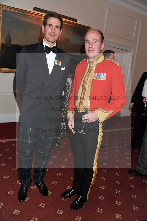 Left to right, PRINCE PAVLOS OF GREECE and LIEUTENANT COLONEL JONATHAN BARTHOLOMEW at a dinner in aid of Caring For Courage - The Royal Scots Dragoon Guards Afghanistan Welfare Appeal held at The Royal Hospital Chelsea, London SW3 on 20th October 2011.