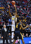 SAN DIEGO, CA - MARCH 16:  West Virginia Mountaineers forward Wesley Harris (21) shoots a three-pointer over Murray State Racers guard Jonathan Stark (2) during a first round game of the Men's NCAA Basketball Tournament at Viejas Arena in San Diego, California.  (Photo by Sam Wasson)