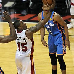 Jun 21, 2012; Miami, FL, USA; Miami Heat point guard Mario Chalmers (15) shoots against Oklahoma City Thunder point guard Russell Westbrook (0) during the first quarter in game five in the 2012 NBA Finals at the American Airlines Arena. Mandatory Credit: Derick E. Hingle-US PRESSWIRE