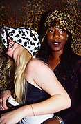 Two Women in Leopard Print Hats, Spoilt For Choice club, London, 1998