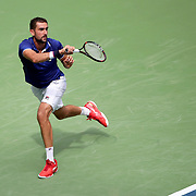 2017 U.S. Open - August 28.  DAY ONE. Marin Cilic of Croatia in action against Tennys Sandgren of the United States during the Men's Singles round one match at the US Open Tennis Tournament at the USTA Billie Jean King National Tennis Center on August 28, 2017 in Flushing, Queens, New York City.  (Photo by Tim Clayton/Corbis via Getty Images)